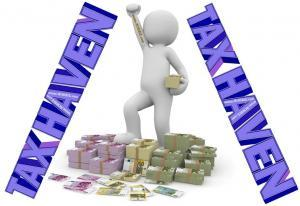 A Man standing on currencies with tax haven sign