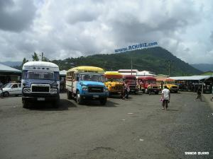 Parked buses with hills view at Samoa